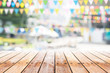 canvas print picture - Empty wooden table with party in garden background blurred.