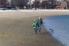 Kids Running Along The Seashor...