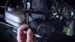 4K Technical Shot Of Mechanic Repairing Car