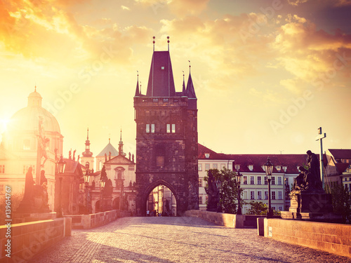 Poster Prague Charles bridge tower in Prague on sunrise