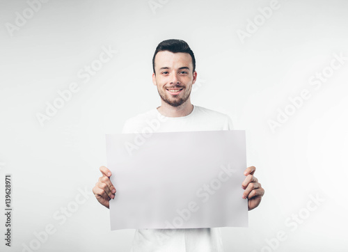 isolated on white background man holds a poster bearded