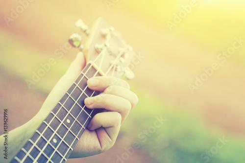 woman handicraft playing ukulele  Hands playing a musical