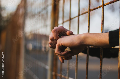 Hands in jail Canvas Print