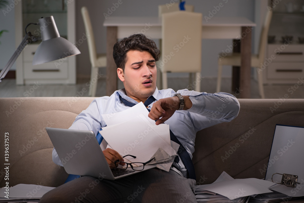 Fototapeta Businessman workaholic working late at home