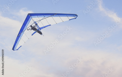 Spoed Fotobehang Luchtsport Vintage photo of Hang Glider flying in the sky