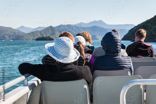 Poster New Zealand tourists on boat cruise in Marlborough Sounds, New Zealand