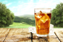 Ice Tea On Wooden Old Table In...