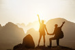 Couple backpackers hikers mountains sunset