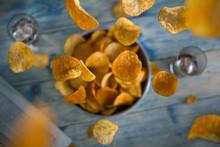 Crisps Falling Into A Bowl
