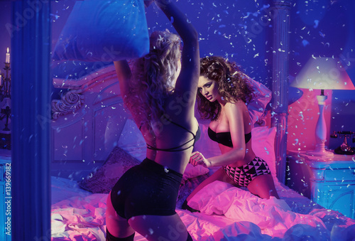 Printed kitchen splashbacks Artist KB Two sensual girlfriends fighting with pillows