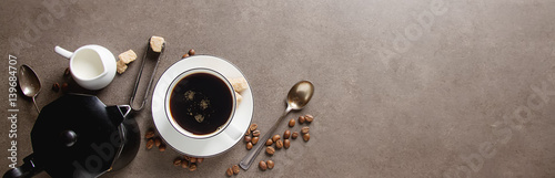 Wall Murals Cafe White cup of hot black coffee with milk and sugar. Gray background. Space for text.