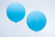 Two Blue Inflated Balloons