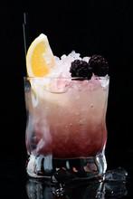 Bramble Cocktail On A Dark Background