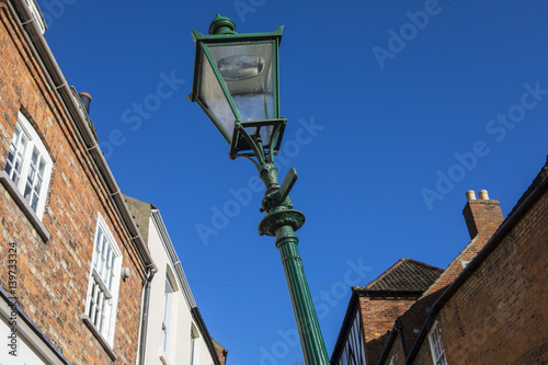 Fotografia  Leaning Lamp Post on Steep Hill in Lincoln