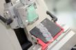Closeup of machine producing thin squares