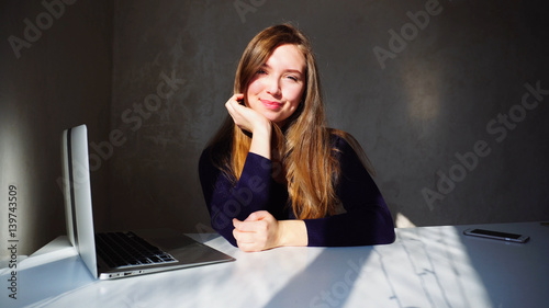 Valokuvatapetti Portrait of dimples young girl with laptop, beautiful woman sitt