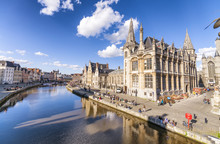 GENT, BELGIUM - MARCH 2015: Tourists Visit Ancient Medieval City. Gent Attracts More Than 1 Million People Annually