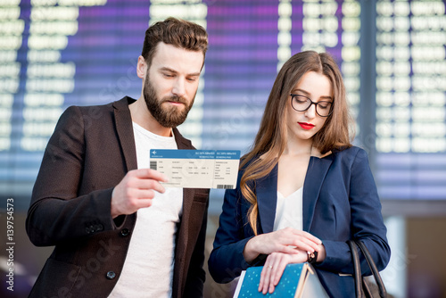 Stressed Out Students How Boarding >> Stressed Business Couple Looking At The Boarding Pass Checking The