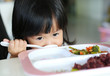 Close-up asian girl age about 2 years old eating