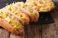 Delicious Hot Dog With Sausage, Sour Cabbage And Mustard Close-up. Horizontal