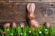 Chocolate Easter Bunny And Eggs On Wooden Background