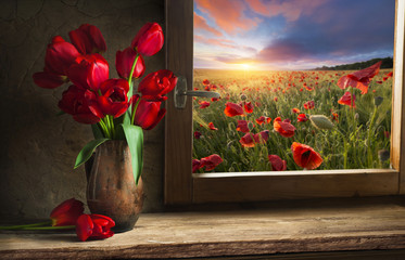 Fototapeta Tulipany Bouquet of tulip flowers in vintage vase on the shelf over rough wooden background, rustic interior decor
