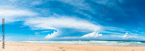 Poster Australie The panoramic view of the ocean beach with beautiful bright cloudy sky in Gold Coast, Australia