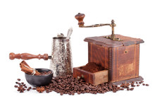 Old Coffee Grinder Maker And Coffee Beans.