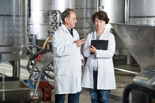 Deurstickers Toscane Wine maker shows equipment on winery