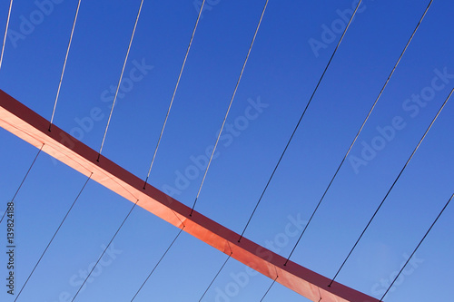 Fototapety, obrazy: Cables and tower of the suspension bridge