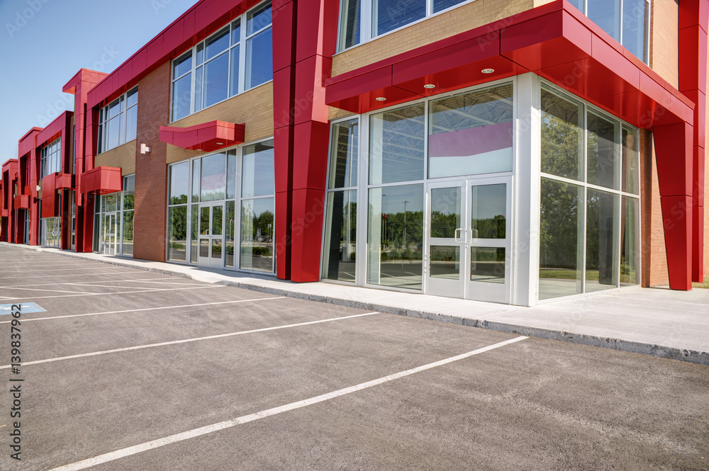 Fototapeta Unoccupied generic store front, business or professional office space.