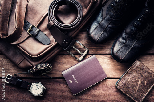 Fototapeta Still life with Men's casual outfits with leather accessories on brown wooden background, beauty and fashion, travel concept obraz