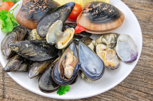 Raw seafood mollusks on wooden table