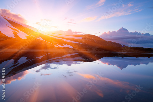 Printed kitchen splashbacks Purple Mountain Lake in the spring. Landscape in the morning. Last snow on the hills. Reflection of the sky in water. Carpathians, Ukraine, Europe
