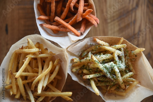 Overhead view of a selection of fries Poster