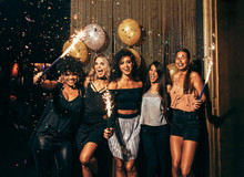Group Of Friends Partying In Nightclub