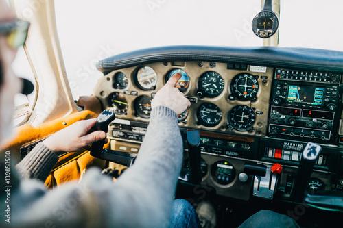 Fotografie, Obraz  Flight instructor and student inside small Piper aircraft