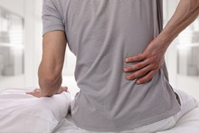 Man Suffering From Back Pain A...