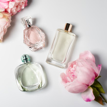 Perfume Bottles With Flowers O...