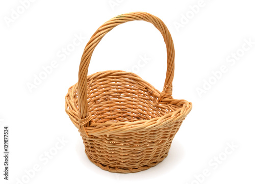 Fotografie, Obraz  Empty fruit wicker basket isolated on white background