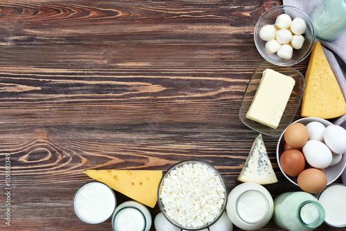 Fototapeta Fresh dairy products on wooden background obraz na płótnie