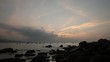 A sunrise over the south China sea in Vung Lam Bay Vietnam with fishing boats coming and going.