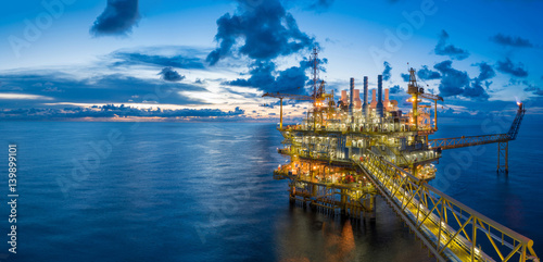 Fotografía  Panorama of Oil and Gas central processing platform in twilight, offshore hard work occupation twenty four working hours
