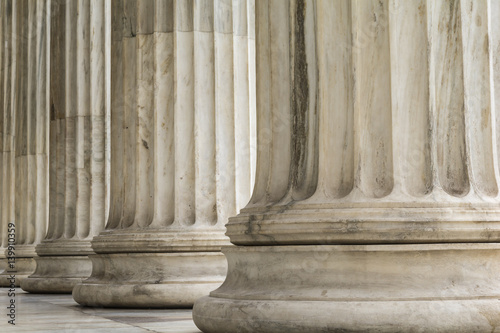 Photo Colonnade of  Ionic order columns, close up.