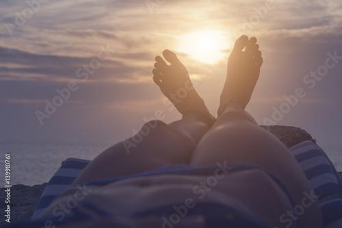 Fototapeta Enjoying the sea / ocean with a sunset on horizon. obraz na płótnie