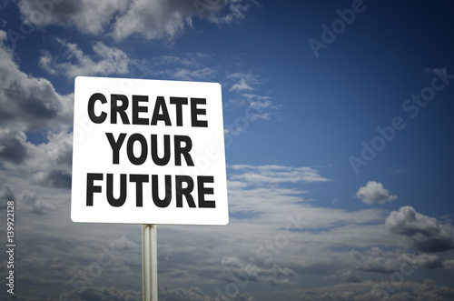 Photo  Create your future written on road sign with blue sky background