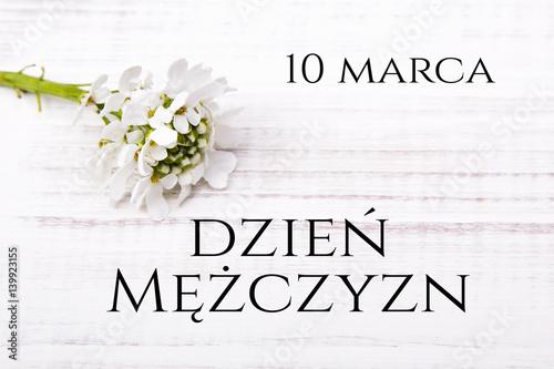 Men's day card with Polish words DZIEŃ MĘŻCZYZN and  coffee beans cup on white wooden background - fototapety na wymiar