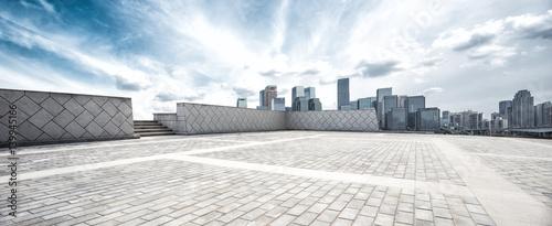 Fototapety, obrazy: empty floor and modern city in sunny sky