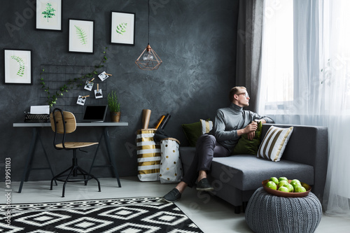 Hipster sitting on a couch Poster Mural XXL