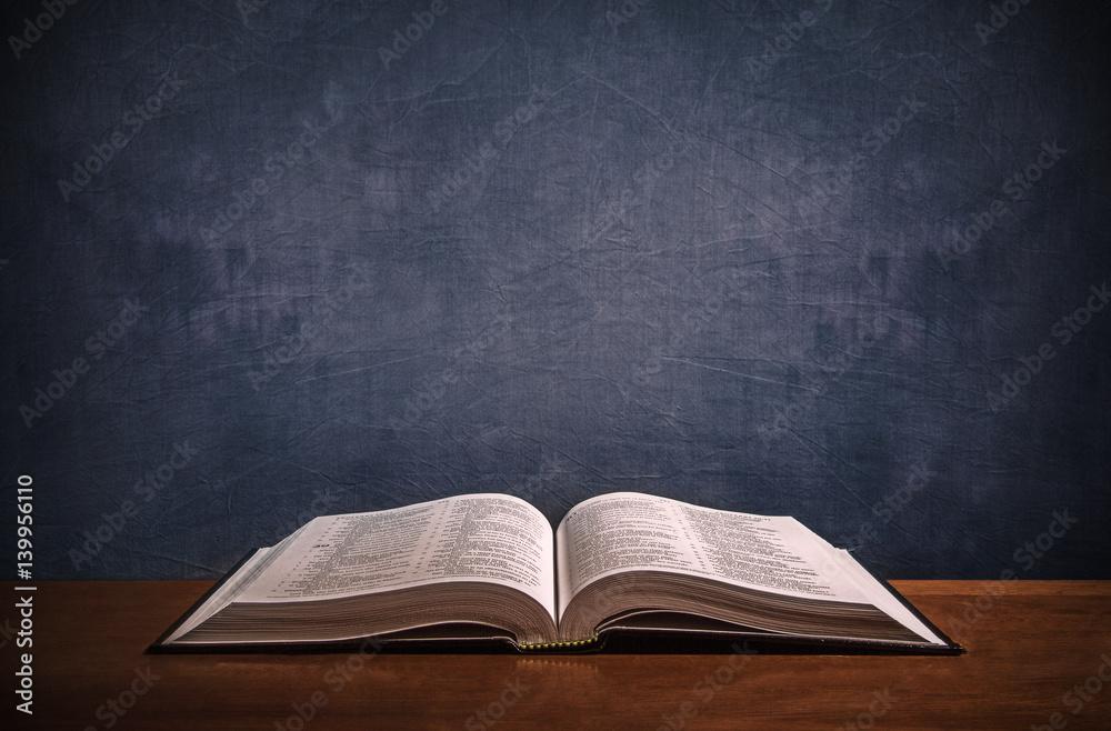 Fototapety, obrazy: Open Bible on a wood desk